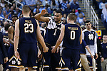 05 February 2017: Notre Dame's Austin Torres (1) meets Martinas Geben (LTU) (23) and Rex Pflueger (0) as they head to the bench during a timeout. The University of North Carolina Tar Heels hosted the University of Notre Dame Fighting Irish at the Greensboro Coliseum in Greensboro, North Carolina in a 2016-17 Division I Men's Basketball game. The game had been postponed one day and moved from Chapel Hill due to a water shortage. UNC won the game 83-76.