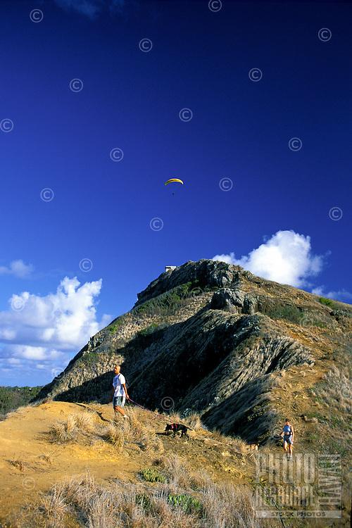 Two hikers enjoying view on Lanikai ridge trail