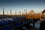 Early morning on the Grand Canal in Venice. Showing San Maria della Salute with dome in scaffolding. May 2007 Italy.