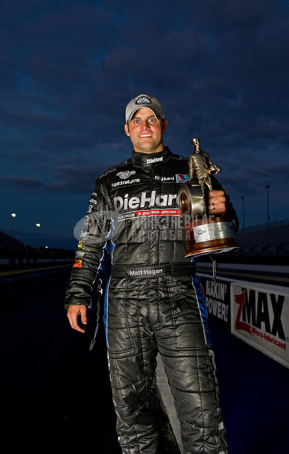 Sept. 18, 2011; Concord, NC, USA: NHRA funny car driver Matt Hagan poses for a portrait after winning the O'Reilly Auto Parts Nationals at zMax Dragway. Mandatory Credit: Mark J. Rebilas-