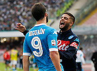 Napoli's Gonzalo Higuain celebrates after scoring with teammate  Lorenzo Insigne  during the Italian Serie A soccer match between SSC Napoli and AC Fiorentina  at San Paolo stadium in Naples,October 18, 2015