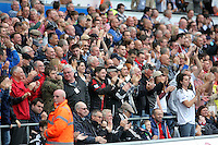 Pictured: Swansea supporters celebrating the goal scored by Bafetimbi Gomis Sunday 30 August 2015<br /> Re: Premier League, Swansea v Manchester United at the Liberty Stadium, Swansea, UK