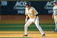 Evan Stephens #5 of the Wake Forest Demon Deacons takes his lead off of second base against the UNC-Asheville Bulldogs at Wake Forest Baseball Park on February 28, 2012 in Winston-Salem, North Carolina.  The Demon Deacons defeated the Bulldogs 9-8.  (Brian Westerholt/Four Seam Images)