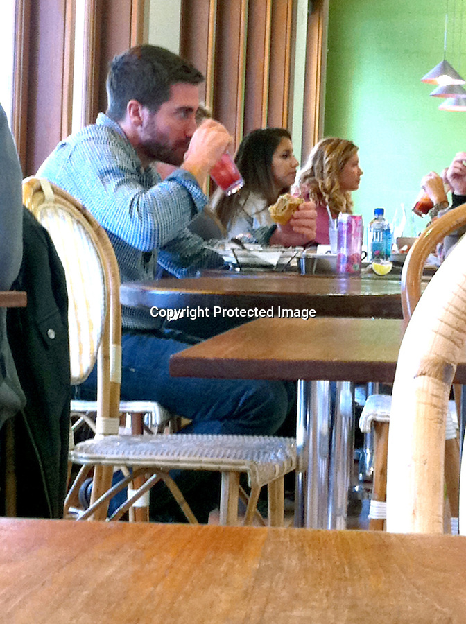 December 15th 2010 Exclusive ..Jake Gyllenhaal  eating lunch all alone at a trendy health food restaurant called .M's Café on Melrose ave in Hollywood California. Jake was drinking juice & eating a $20 Ahi tuna burger sandwich while reading a magazine. Jake is growing out his beard because is so cold outside & Taylor Swift loves it!..AbilityFilms@yahoo.com.805-427-3519.www.AbilityFilms.com