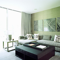 In the media room photographs by Stephen Meisel line the wall above the L-shaped sofa and the ottoman and coffee table are by Shamir Shah