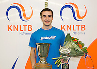 March 15, 2015, Netherlands, Rotterdam, TC Victoria, NOJK, Winner boys 18 years Guy den Heijer<br /> Photo: Tennisimages/Henk Koster