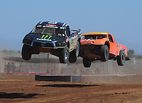 Apr 16, 2011; Surprise, AZ USA; LOORRS driver Johnny Greaves (16) leads Adrian Cenni (11) during round 3 at Speedworld Off Road Park. Mandatory Credit: Mark J. Rebilas-.