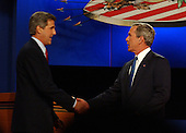 Coral Gables, FL - September 30, 2004 -- United States President George W. Bush, right, shakes hands with his Democratic challenger United States Senator John F. Kerry (Democrat of Massachusetts)  at the start of the first of their three scheduled meetings at the University of Miami in Coral Gables, Florida on September 30, 2004..Credit: Ron Sachs / CNP