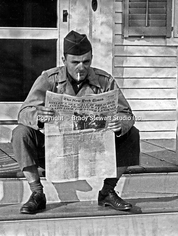 Martha's Vineyard MA:  Brady and Marjorie Zapp Stewart were married in Valley Cottage New York on June 3rd, 1944. While on his honeymoon at Martha's Vineyard, he was recalled to base due to the D-Day invasion. Marjorie Stewart snapped this photograph of Brady Stewart Jr reading the news of the invasion - 1944