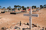 The grave of Crocodile Harry, a local eccentric and miner, in the Coober Pedy cemetery.  The outback town is known as the opal mining capital of Australia.  Coober Pedy, South Australia, AUSTRALIA.