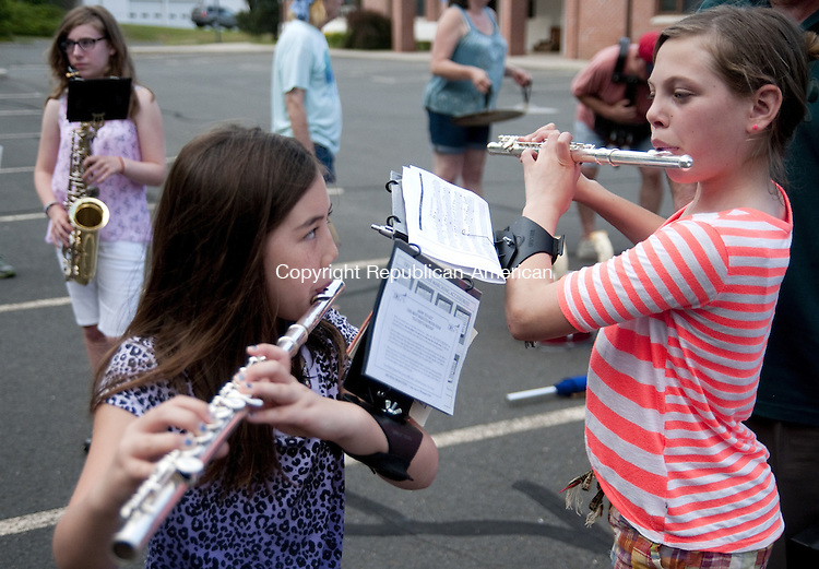 BARKHAMSTED, CT - 01 JULY 2014 -- Samantha Lockwood, 9, of Norfolk and Danielle Ray, 11, of New Hartford practice flutes before marching with the Star Band in Barkhamsted Thursday evening to prepare for today's parade.  Alec Johnson/ Republican-American