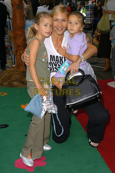 "TANIA BRYER & DAUGHTERS.At the Uk Premiere of ""Madagascar"",.Odeon Cinema Leicester Square, London, .July 3rd 2005..full length kids family children tanya.Ref: CAN.www.capitalpictures.com.sales@capitalpictures.com.©Can Nguyen/Capital Pictures"