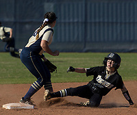NWA Democrat-Gazette/BEN GOFF @NWABENGOFF<br /> Nicole Hendrix of Bentonville makes it to second safe after a throw got past Alyssa Cordell, Bentonville West second baseman, Tuesday, April 10, 2018, during the game at Bentonville West's Wolverine Athletic Complex in Centerton.