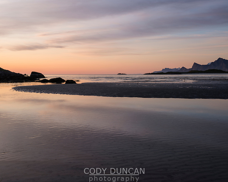 Soft glow of the midnight sun over Ytresand beach, Moskenesøy, Lofoten Islands, Norway