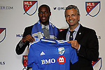 15 January 2015: Romario Williams (UCF) was selected third overall by the Montreal Impact. With head coach Frank Klopas (right). The 2015 MLS SuperDraft was held at the Pennsylvania Convention Center in Philadelphia, Pennsylvania.