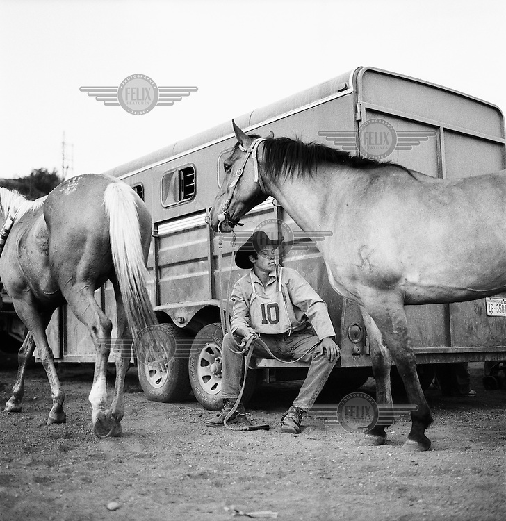 Josh Cate with his horse Perry before the final race. The Omak Suicide Race is part of the Omak Stampede, a rodeo which is held on the Colville Native American / Indian Reservation...