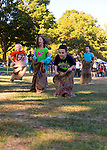Old Bethpage, New York, U.S. 29th September 2013.  Children hop in burlaps bags for the Sack Race at The Long Island Fair. A yearly event since 1842, the county fair now is held at a reconstructed fairground at Old Bethpage Village Restoration.