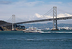 A Ferry goes past the SF Bay Bridge