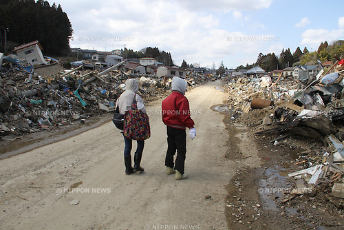 (March, 28th, 2011) Kesennuma, Miyagi, Japan. Two weeks after the tsunami, this port town struggles to recover.  Mrs. Abe and her daughter, Mrs. Fukuhara, drove up from Sendai for a family funeral.  They search through the wreckage for anything left of the family home..