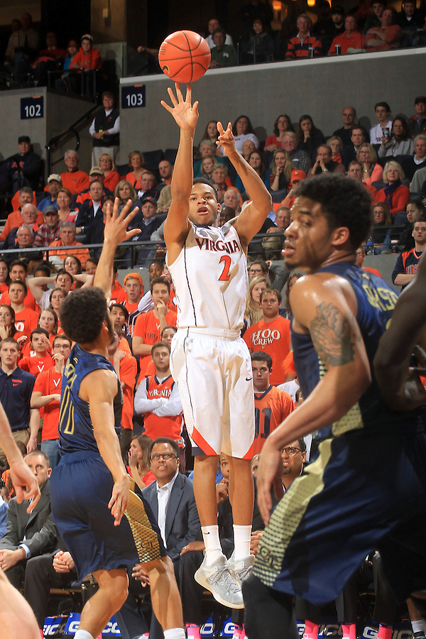 Virginia guard B.J. Stith (2) shoots a 3-point basket next to Georgia Tech guard Josh Heath (11) during an NCAA basketball game Thursday Jan. 22, 2015, in Charlottesville, Va. Virginia defeated Georgia Tech 57-28. (Photo/Andrew Shurtleff)