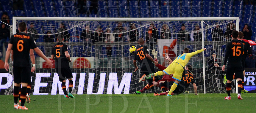 Calcio, semifinale di andata di Coppa Italia: Roma vs Napoli. Roma, stadio Olimpico, 5 febbraio 2014.<br /> Napoli forward Dries Mertens, of Belgium, in yellow, scores during the Italian Cup first leg semifinal football match between AS Roma and Napoli at Rome's Olympic stadium, 5 February 2014.<br /> UPDATE IMAGES PRESS/Isabella Bonotto