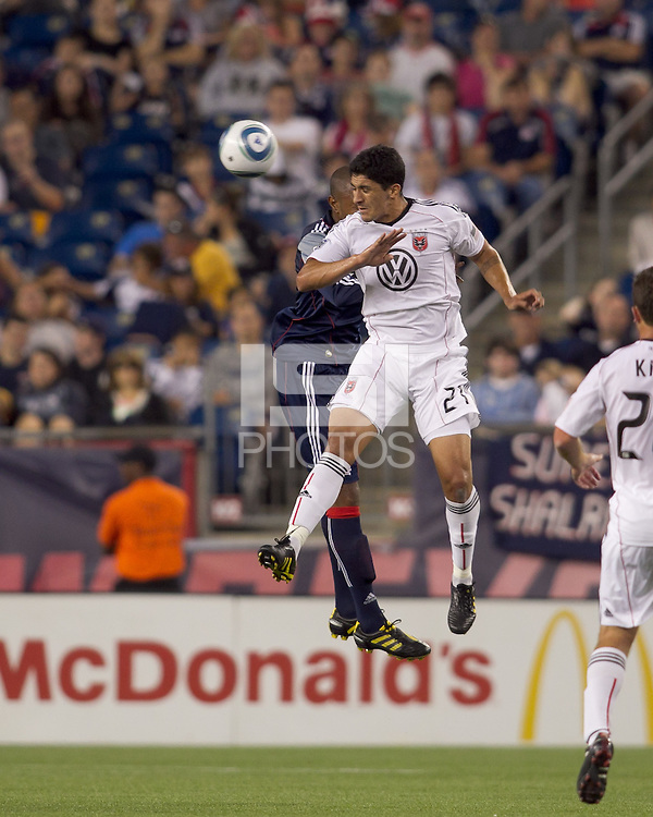 DC United forward Pablo Hernandez (21) and New England Revolution defender Cory Gibbs (12) battle for head ball. The New England Revolution defeated DC United, 1-0, at Gillette Stadium on August 7, 2010.