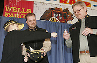 """Thursday March 3, 2006  Anchorage, Alaska   KJ Peck of Butte Montana chooses a name from the hat for a Cabela's """"Outfitter Award"""" at the musher's pre-race drawing and banquet, the largest banquet in Alaska at the Eagan Center."""