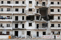 Photographer: Rick Findler/Borderline News..20.01.13 A housing block on the edge of Aleppo, Northern Syria, displays the damage from heavy sheling from President Assad's forces.