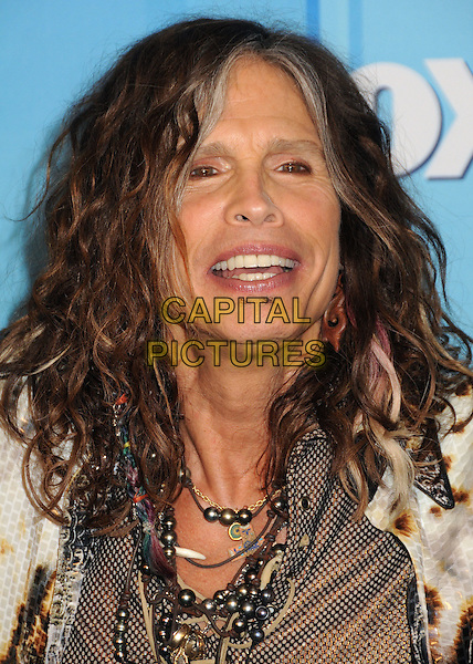 Steven Tyler of Aerosmith.American Idol Season 11 Finale - Press Room held at Nokia Theatre LA Live, Los Angeles, California, USA..May 23rd, 2012.headshot portrait brown beige necklace smiling .CAP/ADM/BP.©Byron Purvis/AdMedia/Capital Pictures.