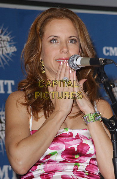 KELLY PRESTON.2006 CMT Music Awards held at The Curb Event Center at Belmont University, Nashville, Tennessee, USA - Pressroom..April 10th, 2006.Photo: George Shepherd/AdMedia/Capital Pictures.Ref: GS/ADM.half length hands to mouth microphone ring bracelet microphone.www.capitalpictures.com.sales@capitalpictures.com.© Capital Pictures.