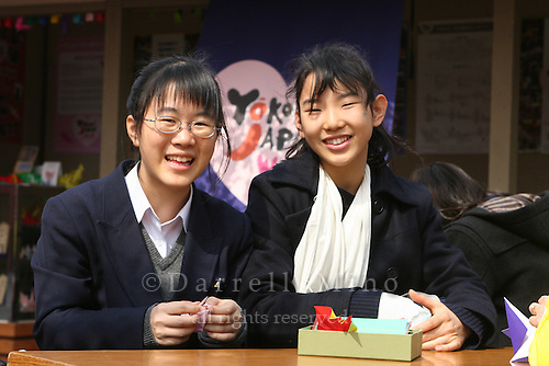 Mar 9, 2006; Tokyo, JPN; Asakusa.School girls fold paper cranes just outside the the Senso-ji Buddhist temple...Photo credit: Darrell Miho