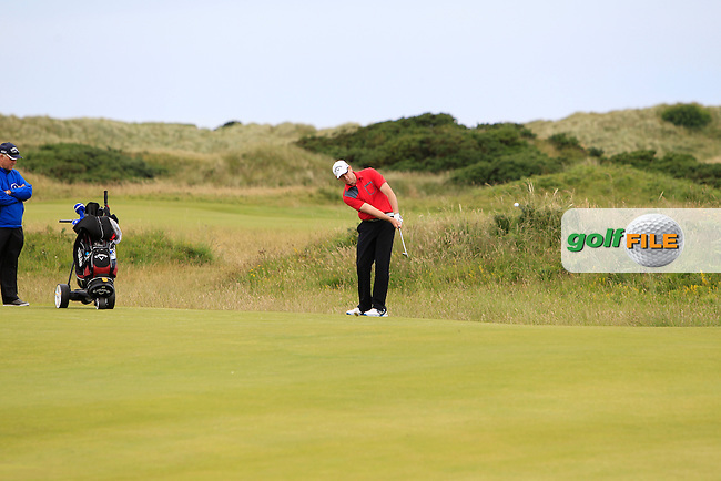 David Sutton (Lurgan) on the 18th green during Round 3 Matchplay of the North of Ireland Amateur Open Championship at Royal Portrush, Dunluce Course on Thursday 16th July 2015.<br /> Picture:  Golffile | Thos Caffrey