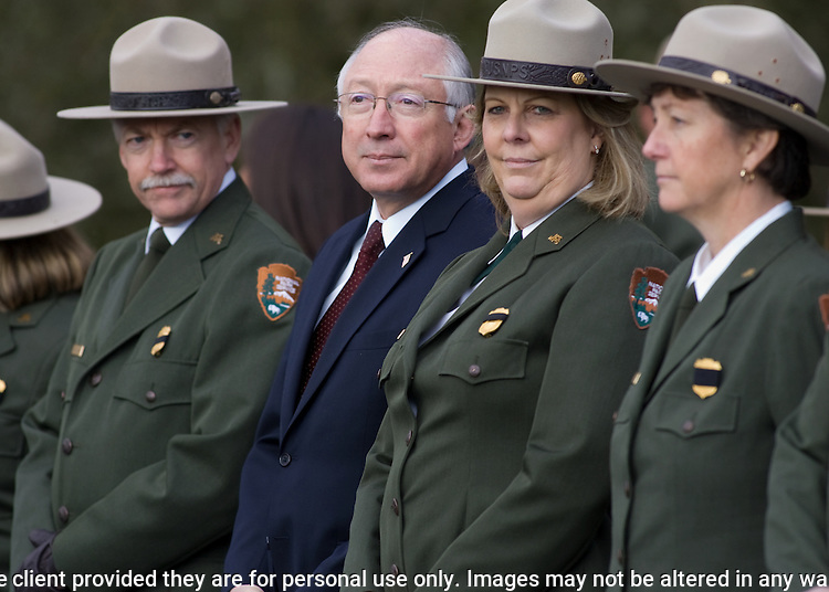 Secretary of the Interior Ken Salazar, second from left, watches the hearse carrying the body of National Park Service Ranger Margaret Anderson during a memorial service at the Pacific Lutheran University for  in Tacoma on January 10, 2010. Anderson, was slain at Mount Rainier on New Years' Day when she set up a road block to intercept a vehicle, driven by Benjamin Barnes, who failed to stop at a chain-up checkpoint.  Barnes, the suspect  in the shooting was found dead was found dead the next day. He had drown in Paradise Creek.  All RIGHTS RESERVED.