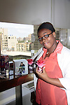 Scholar shows off Justin Bieber perfume as they see the perfume business from sent, packaging, making - The Soledad O'Brien & Brad Raymond Starfish Foundation scholars from all over the country gathered in New York City, New York on July 25, 2014 at the Sensorium, Firmenich International Fine Fragrance where four mentors talked to the students - they were presented with their own fragrance. (Photo by Sue Coflin/Max Photos)