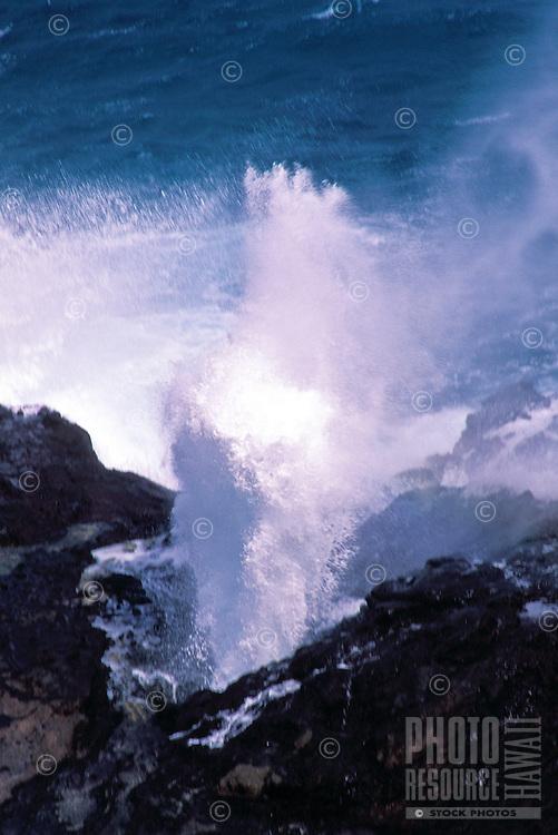 Halona blow hole spouting, near sandy beach on Oahu