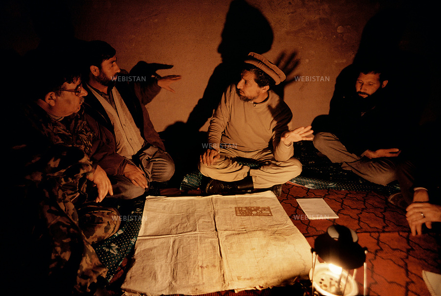 Afghanistan. Takhar Province. Dasht-e-Ghala. 2000. At the bunker of Shafagh, Commander Massoud (1953-2001), chief of the Northern Alliance, prepares with his men, in front of a map, an offensive on the positions of the Taliban. <br /> <br /> Afghanistan. Province du Takhar. Dasht-e-Ghala. 2000. Au bunker de Shafagh, le commandant Massoud (1953-2001), chef de l'Alliance du Nord, pr&eacute;pare avec ses hommes, devant une carte, une offensive sur les positions des Talibans.