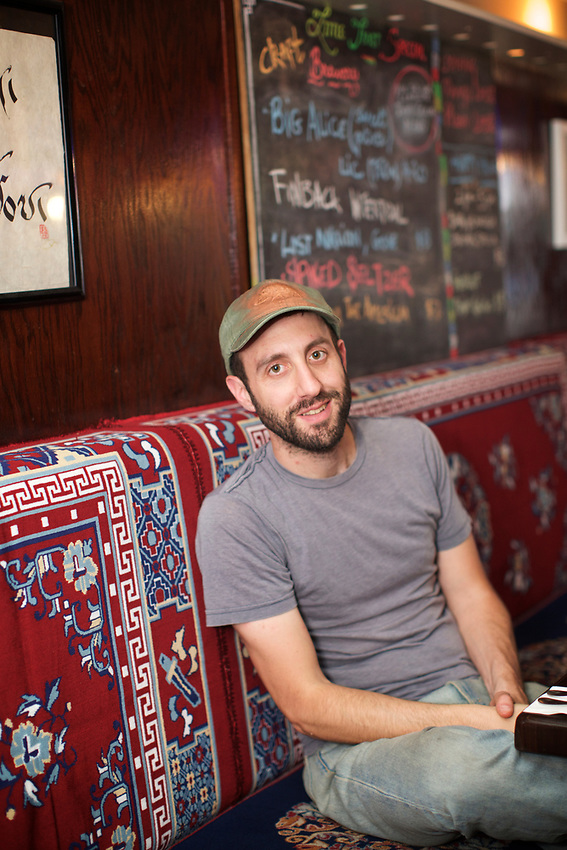 Queens, NY - July 10, 2017: Jeff Orlick at Little Tibet, the 2016 winner of the Momo Crawl in Jackson Heights.<br /><br />Credit: Clay Williams for Edible Queens.