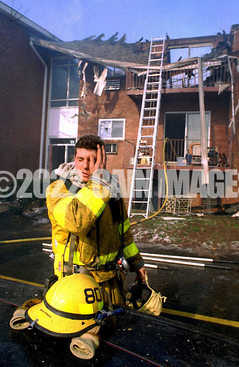 FILE PHOTO: Brad Panaia, a Lower Makefield, Pa. firefighter, wipes his brow after a four alarm apartment building fire that displaced forty residents from their homes, Feb. 3, 1993, in Morrisville, Pa. No one was injured in the blaze. (photo by William Thomas Cain) WILLIAM THOMAS CAIN NEWSMAKERS