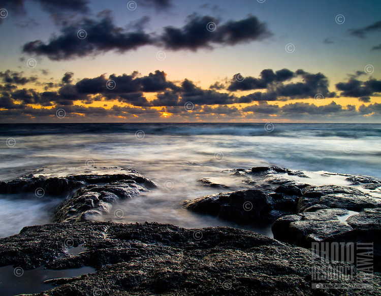 Sunset at the rocky shoreline of Keahole Point, Big Island.