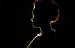 silhouette of the profile of a woman with short curly hair
