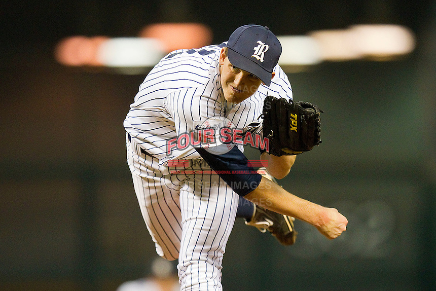 Starting pitcher Austin Kubitza #21 of the Rice Owls follows through on his delivery against the Texas A&M Aggies at Minute Maid Park on March 5, 2011 in Houston, Texas.  Photo by Brian Westerholt / Four Seam Images