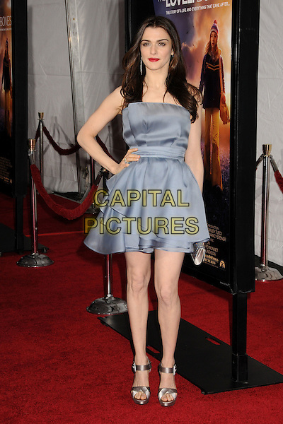 "RACHEL WEISZ .""The Lovely Bones"" Los Angeles Premiere held at Grauman's Chinese Theatre, Hollywood, California, USA, .7th December 2009..full length blue grey gray dress  silk  strapless tiered layered hand on hip silver satin sandals platform clutch bag .CAP/ADM/BP.©Byron Purvis/Admedia/Capital Pictures"