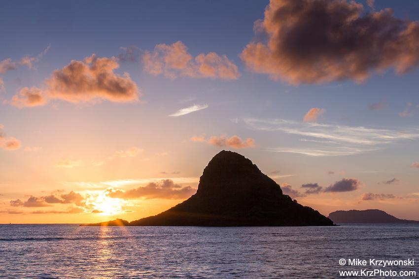 Sunrise behind Mokoli'i aka  Chinaman's Hat Island, Kualoa Beach Park, Oahu, Hawaii
