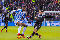 Huddersfield Town's forward Steve Mounie (24) takes on Crystal Palace's midfielder Yohan Cabaye (7) during the EPL - Premier League match between Huddersfield Town and Crystal Palace at the John Smith's Stadium, Huddersfield, England on 17 March 2018. Photo by Stephen Buckley / PRiME Media Images.