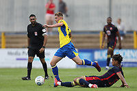 Taylor Miles of St Albans skips away from Terence Vancooten of Stevenage during St Albans City vs Stevenage, Friendly Match Football at Clarence Park on 13th July 2019