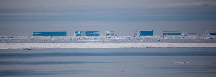 Title: Fata Morgana, or superior mirage off the east coast of northeast Arctic Greenland, near Nioghalvfjerdsfjorden, or 79 Glacier