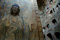 Buddha carved inside a grotto, Yungang Grottoes, Shanxi, China.