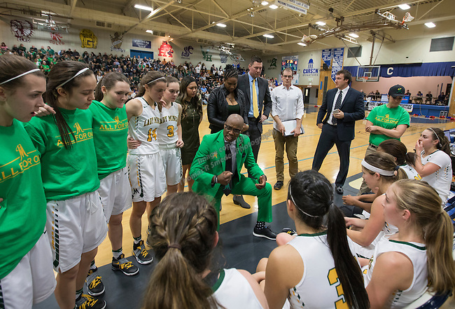 Manogue coach Carlnel Wiley talks to his team during a timeout against Reno in the Regional Championship Basketball game held at Carson City High School on Saturday, February 18, 2017.