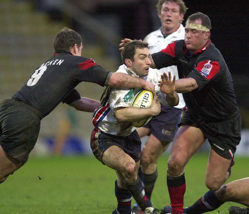 Photo. Richard Lane.Saracens v Sale Sharks at Vicarage Road. Powergen Cup. 22-12-2002.Bryan Redpath is tackled by Richard Hill and Kyran Bracken.