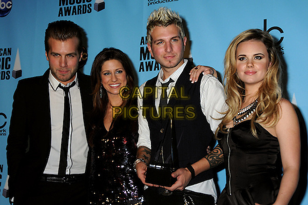 GLORIANA - Tom Gossin, Cheyenne Kimball, Mike Gossin and Rachel Reinert .At the 2009 American Music Awards - Press Room held at the Nokia Theatre L.A. Live, Los Angeles, California, USA, .22nd November 2009..AMA AMAs half length band group black waistcoat tie suit white shirt strapless sequined sequin dress  tattoos trophy award .CAP/ADM/BP.©Byron Purvis/AdMedia/Capital Pictures.